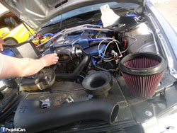 Now that Louie Bustillos has removed the stock airbox, it is time to install his K&N Mustang GT air intake system.