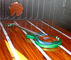 SEM Bed liner a Missing Link Guitar and four leaf clovers are part of the look for Lucky Luciano body modifications on his GMC Sierra at the SEMA Show in Las Vegas, Nevada