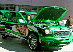 Matt Andrews Airbrushing put on the final touches of the beautiful models on the Lucky Luciano GMC Sierra