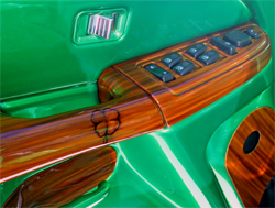 Four leaf clover and wood show off door panel on the 2005 GMC Sierra Crew Cab modified by Lucky Luciano Customs