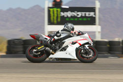 K&N Human Resources Manager, Lyn Rosas and her Yamaha YZF-R6 spend quality time together bonding at Chuckwalla Valley Raceway.