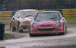 Mad Mark driving red car in A Final
