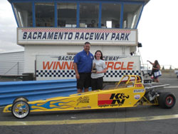 Madison Whitten with Division 7 director Mike Rice and her Bracket Jr. Dragster.