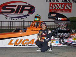 NHRA Sportsman Class Racer Andrew Madrid in front of one of the fastest dragsters on the Sportsman Class circuit