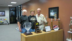 Norm McDonald, his wife Lucy, and Malcom Smith recently posed for a picture at Malcolm Smith Motorsports