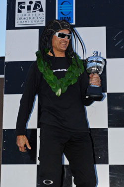The trophy and laurels are all business, but the headgear and glasses say let's start the party in Monaco.