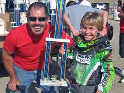 Marshall Stewart with winning trophy and track announcer Mike Yellich
