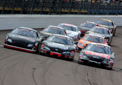 Drivers raced three-wide as they crossed the start-finish line for the final lap of the race.