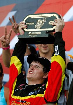 NASCAR K&N Pro Series East racer Max Gresham celebrates.