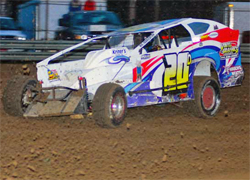 Heavy Rain turned Mercer Raceway Park into a rough track where Del Rougeux hit a rut and had to pit for repairs, photo by Oyler Action Photo