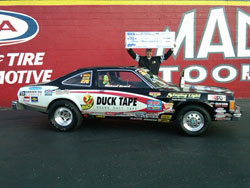 Beard hoists the big check overhead after winning his second IHRA Stock World Championship by defeating an all-star cast in the long-postponed IHRA Tournament of Champions at Rockingham Dragway