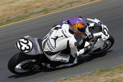 Ben Nostrom knee drags on his #23 Michael Jordan Motorsports Suzuki GSXR-1000 race bike