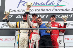 Lewis celebrates his first F-3 Italia win on the podium with his mechanic Marco Sbabo.