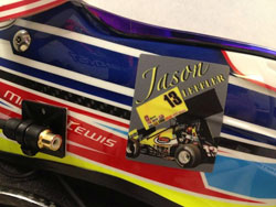 Lewis dons a sticker on his racing helmet in memory of his friend Jason Leffler.
