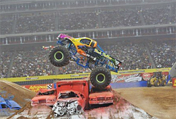 Monster Jam's Black Stallion puts air under his truck at Reliant Stadium. photo by Kenny Lau