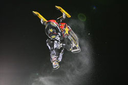 Backflip at Winter X-Games 15 for the Bomb Squad Battalion Racing Team