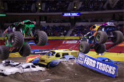 Monster Trucks Black Stallion and Grave Digger battle it out in front of a sold out crowd