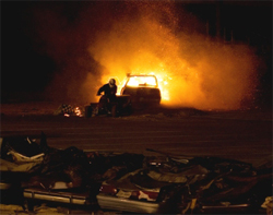 Black Stallion Driver Michael Vaters destroys a junk car with a Kamikaze Jet Powered 4-Wheeler during Monster Truck action