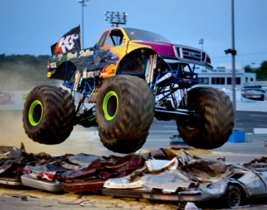 Flames Destroy Junk Car For Fun During Monster Truck Action
