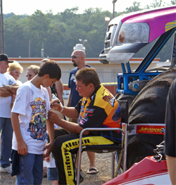 Black Stallion owner driver Michael Vaters signs autographs at the pit party