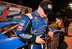 Justin Haley autographs the K&N mini helmet after his win at Greenville Pickens Speedway