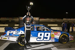 Patrick Staropoli holds his trophy up high for all his fans to see at Irwindale Speedway NAPA Auto Parts 150.