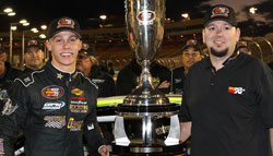 Tony Yorkman (right), head of sports marketing for K&N, presented the NASCAR K&N Pro Series West championship to Dylan Kwasniewski last year at Phoenix. Kwasniewski, one of the sport's rising stars, has a chance to become the first driver to win both the K&N Pro Series West and East titles in successive years. Getty Images.
