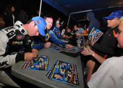 Eric Holmes (right) and Chase Briscoe (left) sign autographs at the Napa Speedway before NASCAR K&N Pro Series West race