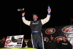NASCAR K&N Pro Series West racer Greg Pursley celebrates his win at Napa Speedway