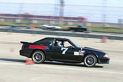 Mike Morrow pushing that newly updated Fox Body Mustang at Hotchkis Cup Autocross Challenge