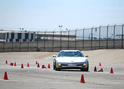 Mary Pozzi in her Corvette, affectionately named Trouble at Hotchkis Cup Autocross Challenge