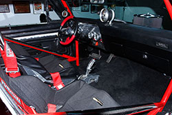 Paul Summers 1972 Chevy Nova with LS7 and Black and red Kirkey race seats adorn the interior with G-Forge 5-point seat belts and an Art Morrison cage