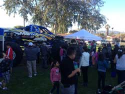 The Shocker Monster truck team helped pass out gifts and sign autographs