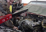Getting ready to remove the engine of Major Jeffrey Calero's Pontiac GTO