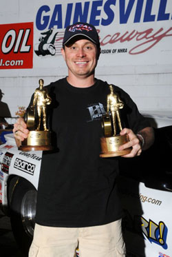 After a combined total of 13 rounds in two classes, Biondo proudly shows off his latest Wally's in Super Stock and Super Gas in Gainesville Winner's Circle.