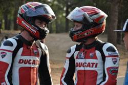 Greg Tracy and Alexander Smith chat at the start line area during a private testing session on the mountain.