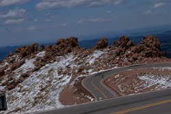 To reach the top of Pikes Peak you must first overcome some brutal twists and turns.