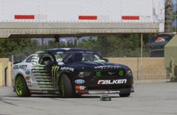 Vaughn Gittin Jr. chasing RC drift car through K&N Facility.