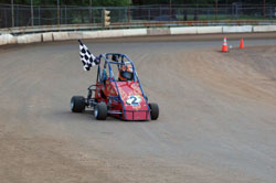 Carrying a checkered flag for her victory lap is a comfortable position for the 15-year-old teenager, one she plans on repeating again in 2011 in her new winged 270.