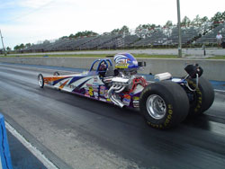 Robbie Officer and the 2007 OFFICER BOYZ half scale Advanced Jr. Dragster ready for track action