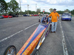 15 year old Advanced Jr. Dragster Driver Robbie Officer and father Mark Officer focus on the upcoming race