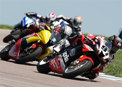 Riders Chaz Davies and Aaron Gobert work it out on the Aprilia RSV1000Rs in AMA Daytona SportBike Series Race