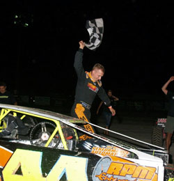 After a recent feature race at the Blackock Speedway, Russell Morseman crawls out of his car as the victor.