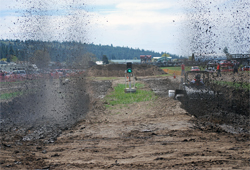 Mud Racers in heads-up action take on a 200 foot course in seconds, photo by Sue Potter