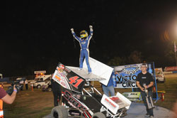 Giovanni Scelzi celebrating a win on top of his Sprint Car at Jr. Sprints
