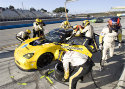 Corvette Racing pit crew works on Corvette C6.R at Mazda Raceway Laguna Seca in Monterey, California, photo by GM Corp.