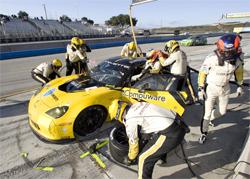 Corvette Racing pit crew works on Corvette C6.R at Mazda Raceway Laguna Seca in Monterey, California, photo by GM Corp.