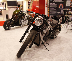 Roland Sands custom bike and futuristic V-REX by Travertson in K&N booth at SEMA show