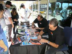 Rick L. Johnson (L)and Dane Cardone (R) sign hero cards at K&N