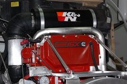 Shown here on top of the Cummins ISX is the new air induction system, and the new Heavy Duty Air Filter assembly from K&N Filters.